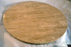 A stylish Travertine Turntable including runners.